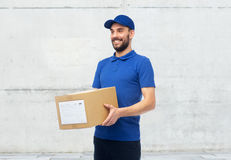 Happy delivery man with parcel box Stock Images