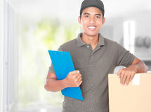 Happy delivery man Stock Photos