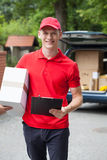Happy delivery man Stock Photography