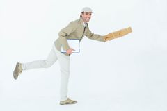Happy delivery man running while holding parcel Royalty Free Stock Photography