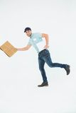Happy delivery man running with package Royalty Free Stock Photo