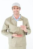 Happy delivery man showing blank note Royalty Free Stock Photos