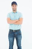 Happy delivery man standing arms crossed Royalty Free Stock Photo