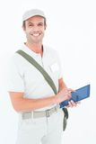 Happy delivery man using digital tablet Royalty Free Stock Images