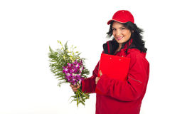 Happy delivery woman with fresh flowers Stock Photos