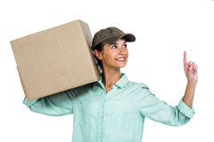 Happy delivery woman holding box pointing up Stock Image
