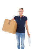 Happy delivery woman holding cardboard box and clipboard Royalty Free Stock Images