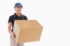 Happy delivery woman holding cardboard box Stock Photos