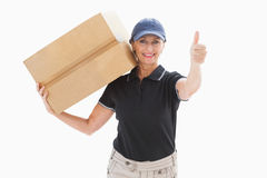 Happy delivery woman holding cardboard box Royalty Free Stock Photo