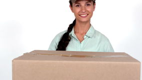 Happy delivery woman holding cardboard box stock video footage