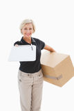 Happy delivery woman looking for signature Royalty Free Stock Image