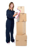 Happy delivery woman preparing an invoice Stock Images