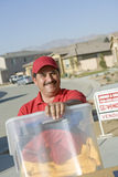 Happy Deliveryman Carrying Container Stock Photos