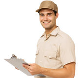 Happy Deliveryman Holding Clipboard Stock Photography