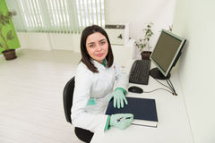 Happy Dentist Assistant Writes Some Notes Stock Photography