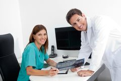 Happy Dentist And Assistant With X-Ray Report Stock Photos