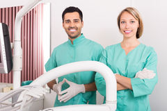 Happy dentist and head nurse Royalty Free Stock Photos