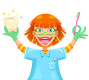 Happy dentist. Happy smiling dentist holding a toothbrush and a shiny tooth Royalty Free Stock Image