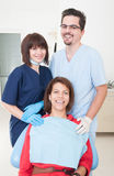 Happy dentist woman, assistant and patient Royalty Free Stock Photo