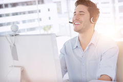 Happy designer laughing during an online communication Royalty Free Stock Image