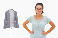 Happy designer looking at camera with hands on hips Royalty Free Stock Photos