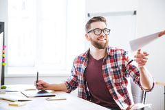 Happy designer using graphic pen tablet and taking documents Royalty Free Stock Photos