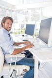 Happy designer working at his desk Royalty Free Stock Photos