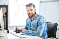 Happy designer working using pen tablet with stylus in office Royalty Free Stock Image