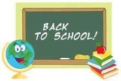 Happy desk globe by a back to school chalk board Royalty Free Stock Photos