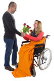 Happy despite disability. Happy women in wheelchair gets flowers gift Stock Photos