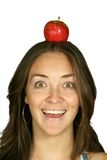 Happy diet - apple on head Royalty Free Stock Images