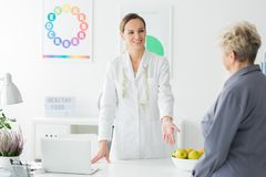 Happy dietitian with measure tape Stock Image