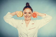 Happy dietitian nutritionist with grapefruit. Royalty Free Stock Photos