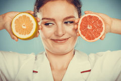 Happy dietitian nutritionist with grapefruit. Royalty Free Stock Photography