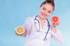 Happy dietitian nutritionist with grapefruit. Stock Photography