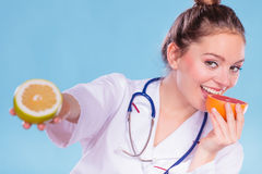 Happy dietitian nutritionist with grapefruit. Royalty Free Stock Image