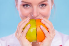 Happy dietitian nutritionist with grapefruit. Stock Images