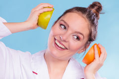 Happy dietitian nutritionist with grapefruit. Royalty Free Stock Photo