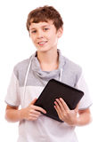 Happy digital tablet computer teen. Happy male  teen Using Tablet Computer or iPad isolated on white background Stock Photo