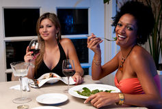 Happy Dinner. 2 Young girls having dinner in a restaurant Royalty Free Stock Photos