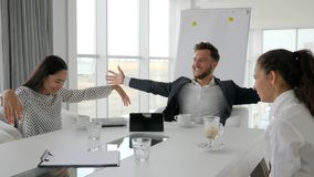 Happy director and employees at break, coffee-break in office, business people drink coffee at table, creative team stock footage