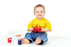 Happy dirty child with paints. Over white background Stock Photos