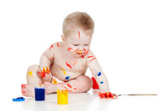 Happy dirty child with paints Royalty Free Stock Photography