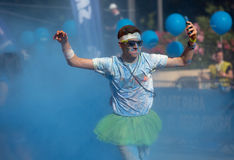 Happy dirty man during   Festival The Color Run in Barcelona Stock Image