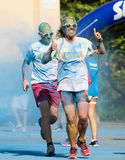 Happy dirty people running at The Color Run Royalty Free Stock Photo