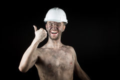 Happy dirty worker in helmet. Royalty Free Stock Images