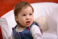 Happy Disabled Baby Girl. Portrait of a cute little girl, not quite two years old, with Downs Syndrome royalty free stock photography