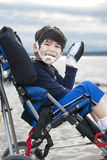 Happy disabled five year old boy in wheelchair Stock Photography