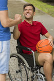 Happy disabled man holding a basketball Royalty Free Stock Photography
