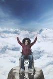 Happy disabled man on mountain peak Royalty Free Stock Photo